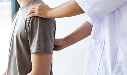 chiropractor working on patients back problem