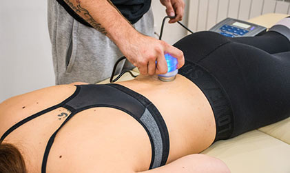 massage therapist working on woman's back