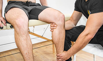 occupational therapist working on knee